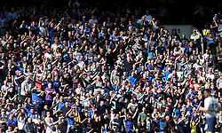 Everton fans celebrate hearing of Manchester City's third goal of the game during the Premier League match at Tottenham Hotspur Stadium, London.
