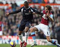 Photo: Rich Eaton.<br /> <br /> Aston Villa v West Ham. The Barclays Premiership. 03/02/2007. Marlon Harewood of West Ham and Olof Mellberg clash