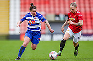 Reading defender Emma Mitchel (3) and Manchester United midfielder Leah Galton (11) run for the ball during the FA Women's Super League match between Manchester United Women and Reading LFC at Leigh Sports Village, Leigh, United Kingdom on 7 February 2021.