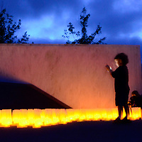 A young visitor takes a cell phone photo of Luminaria Service  at the Flight 93 National Memorial on the eve of the 14th anniversary of the terrorist attack on America near Shanksville, Pennsylvania on September 10, 2015.  UPI/Archie Carpenter