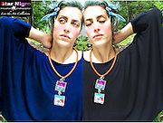 """Graffiti art Necklace created exclusively by Star Nigro <br /> <br /> A one of a kind designed & handmade photo jewel created in the Hudson Valley, NY by Star Nigro. <br /> <br /> About/Materials: This set is made up of one of  my photos of Boston's graffiti encased in glass with gem edges, swaravski crystal <br /> +2 mirrors on back<br /> Can be worn both ways making it a 2 in 1 piece. w/ copper hook and cord. <br /> <br /> Comfortable feel, light weight & durable<br /> <br /> size: 14"""" length x 1 7/8""""width<br /> <br /> price: $52.00<br /> <br /> <br /> <br /> <br /> <br /> <br /> ©2019 All artwork is the property of STAR NIGRO.  Reproduction is strictly prohibited."""