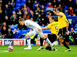 Tranmere Rovers's Eliot Richards is challenged by Bristol Rovers' Mark McCrystal - Photo mandatory by-line: Neil Brookman/JMP - Mobile: 07966 386802 - 08/11/2014 - SPORT - Football - Birkenhead - Prenton Park - Tranmere Rovers v Bristol Rovers - FA Cup - Round One