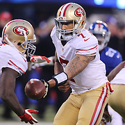 San Francisco 49ers quarterback Colin Kaepernick hands off  to running back Frank Gore during the New York Giants V San Francisco 49ers, NFL American Football match at MetLife Stadium, East Rutherford, NJ, USA. 16th November 2014. Photo Tim Clayton