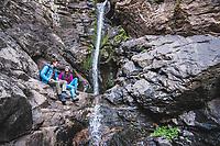 Palmer Larsen and Jules Jimreivat take in Rocky Mouth Waterfall, Sandy, Utah.