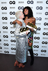 Rose McGowan with the Inspiration Award and Naomi Campbell with the Fashion Icon Award in the press room at the GQ Men of the Year Awards 2018 in Association with Hugo Boss held at The Tate Modern in London.