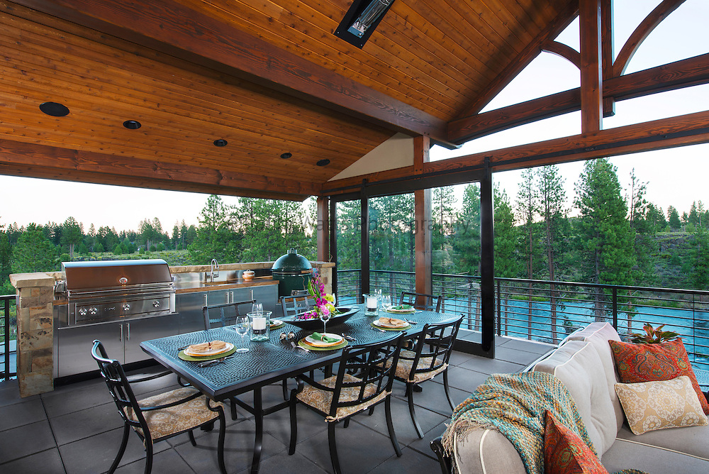 Outdoor dining space on the river with bbq