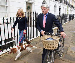 © Licensed to London News Pictures. 19/12/2012. London, UK. Former Conservative chief whip Andrew Mitchell and his wife Sharon are seen as he makes his way to work in London today (19/12/12) the day after CCTV footage was released that cast doubt on his alleged verbal abuse of Downing Street police officers . Photo credit: Matt Cetti-Roberts/LNP