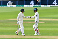 Sam Curran of England and Moeen Ali of England touch gloves after England reach 100 during the first day of the 4th SpecSavers International Test Match 2018 match between England and India at the Ageas Bowl, Southampton, United Kingdom on 30 August 2018.
