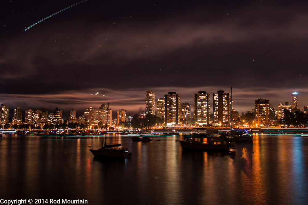 The smoke created from France's fireworks demonstration is illuminated by Vancouver's city lights. The Celebration of Light is an annual fireworks competition and attracts up to 400,000 spectators each night and is the world's largest offshore event. © 2014 Rod Mountain