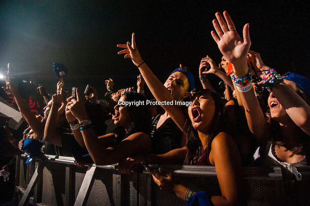 Patrons dance as Tiesto performs during the 2016 Electric Zoo Festival at Randall's Island on September 3, 2016 in New York City.