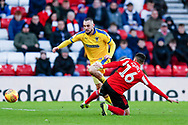 Wimbledon midfielder Dylan Connolly (16)  skips past Sunderland defender Reece James (16)  during the EFL Sky Bet League 1 match between Sunderland and AFC Wimbledon at the Stadium Of Light, Sunderland, England on 2 February 2019.