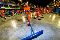 Cleaning crew cleans the course between samba school parades during Carnaval, Sambadrome, Rio de Janeiro, Brazil.