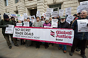 Protesters from War on Want stage a demonstration outside the governments Department for International Trade building in London, England, United Kingdom on 6th February 2018, calling on Members of Parliament MPs to demand the parliamentary scrutiny of trade deals. Protesters hold signs stating people's constituencies to demonstrate the geographical diversity of the protest.