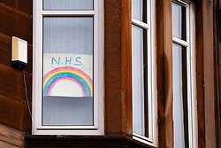 Glasgow, Scotland, UK. 3 April, 2020. Images from the south side of Glasgow at the end of the second week of Coronavirus lockdown. Pictured; hand drawn rainbow NHS message in window of flat in Govanhill . Iain Masterton/Alamy Live News