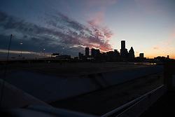 Silhouette of Houston, Texas skyline at sunset.