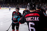 KELOWNA, CANADA - NOVEMBER 23:  Kyle Topping #24 and Kaedan Korczak #6 of the Kelowna Rockets celebrate a second period goal against the Victoria Royals on November 23, 2018 at Prospera Place in Kelowna, British Columbia, Canada.  (Photo by Marissa Baecker/Shoot the Breeze)