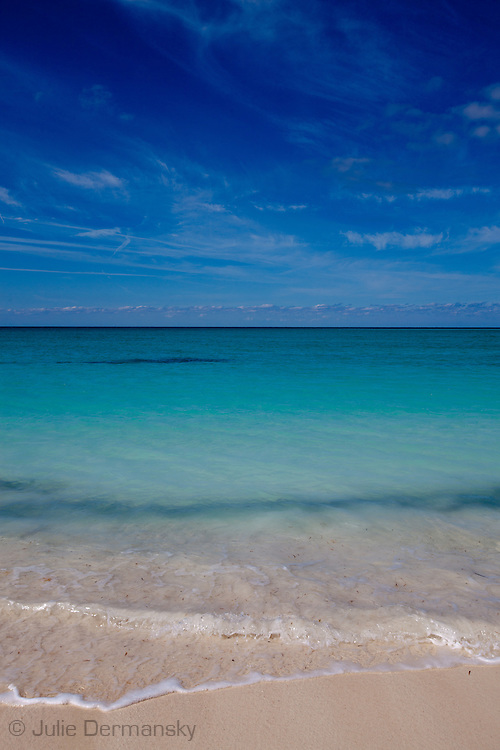 Beach on Nassau with clear turquoise Atlantic water in the Bahamas.