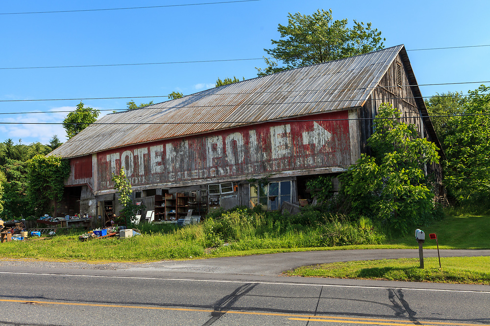 Ortanna, PA, USA- June 2, 2012: An older barn eith Totem Pole Sign on Route 30 Lincoln Highway in Adams County, PA.