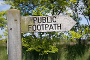 Wooden public footpath sign pointing direction