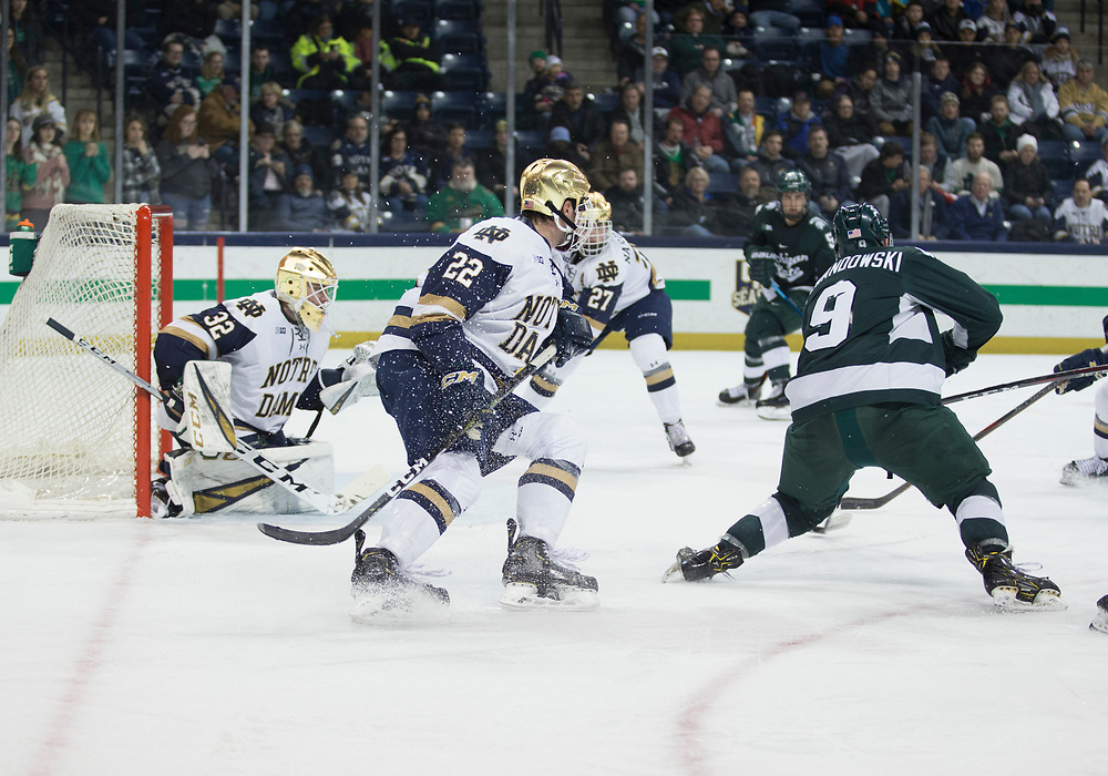 January 25, 2019:  Michigan State forward Mitchell Lewandowski (9) shoots the puck as Notre Dame goaltender Cale Morris (32) looks to make the save during NCAA Hockey game action between the Michigan State Spartans and the Notre Dame Fighting Irish at Compton Family Ice Arena in South Bend, Indiana.  Notre Dame defeated Michigan State 6-3.  John Mersits/CSM