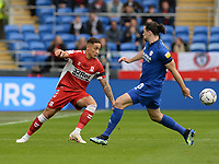 Middlesbrough's Marcus Tavernier is closed down by Cardiff City's Ciaron Brown<br /> <br /> Photographer Ian Cook/CameraSport<br /> <br /> The EFL Sky Bet Championship - Cardiff City v Middlesbrough - Saturday 23rd October 2021 - Cardiff City Stadium - Cardiff<br /> <br /> World Copyright © 2020 CameraSport. All rights reserved. 43 Linden Ave. Countesthorpe. Leicester. England. LE8 5PG - Tel: +44 (0) 116 277 4147 - admin@camerasport.com - www.camerasport.com