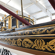 The Royal Barge (Bergantim Real) was built in 1778 by order of Queen Maria I, in Lisbon, for the betrothal of Prince Joao, later King Joao VI. She was manned by 80 oarsmen, 1 coxswain, and 1 bowman. The last time she was in service was in transporting Queen Elizabeth II on the River Tagus during her visit in 1957. The Museu de Marinha (Maritime Museum of Navy Museum) focuses on Portuguese maritime history. It features exhibits on Portugal's Age of Discovery, the Portuguese Navy, commercial and recreational shipping, and, in a large annex, barges and seaplanes. Located in the Belem neighborhood of Lisbon, it occupies, in part, one wing of the Jerónimos Monastery. Its entrance is through a chapel that Henry the Navigator had built as the place where departing voyagers took mass before setting sail. The museum has occupied its present space since 1963.