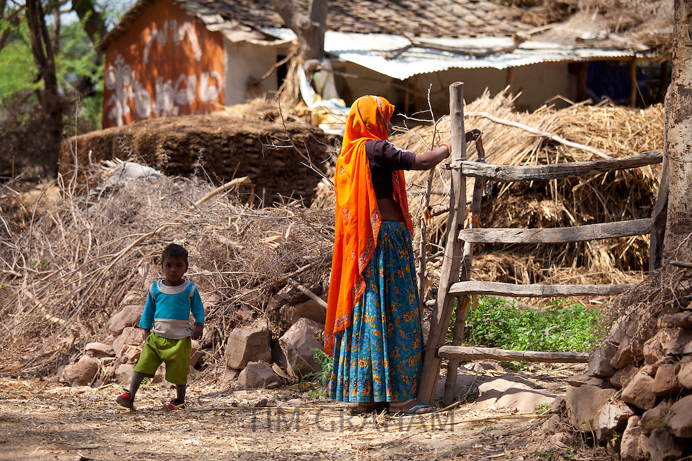 Indian woman villager and child at her smallholding farm at Kutalpura Village in Rajasthan, Northern India
