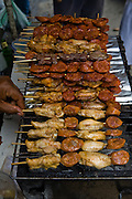 Meat grilling on skewers at Mercado Quinta Crespo, Caracas, Venezuela.