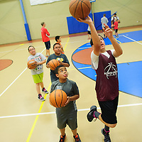 060214  Adron Gardner/Independent<br /> <br /> Call Lemmon, left, watches as Paul Andrade demonstrates layup form at the Rehoboth basketball camp in Rehoboth Monday.