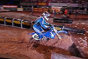 #80 Ryan Rodgers from Dover, PA navigates the treacherous water pit at the 2007 Maxxis AMA Endurocross at the Lazy E Arena in Guthrie, Oklahoma.  Event was won by David Knight #101 on KTM