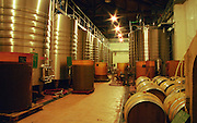 The vat room with stainless steel and epoxy tanks and wooden barrels  Chateau Mont-Redon, Chateauneuf-du-Pape Châteauneuf, Vaucluse, Provence, France, Europe