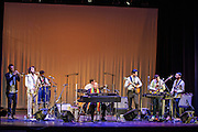 WASHINGTON, DC - February 11th, 2014 - Hailu Mergia (center) performs on the Millennium Stage at the Kennedy Center. Mergia, a star of Ethiopian music in the 1970s as a member of the Walias Band, now drives a cab in Washington, D.C. (Photo by Kyle Gustafson / For The Washington Post)