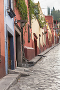 The Spanish colonial style homes along the cobblestone Correo street in the historic center of San Miguel de Allende, Mexico.