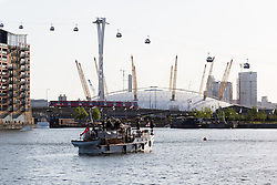 © Licensed to London News Pictures. 16/05/2015. London, UK. Dunkirk Little Ship, Bluebird of Chelsea parades in Royal Victoria Dock in London this evening in front of the O2 Arena. Over 20 Dunkirk Little Ships have gathered in London toay before leaving in the morning to continue their journey to Dunkirk to mark the 75th anniversary of the Dunkirk Evacuations. Photo credit : Vickie Flores/LNP