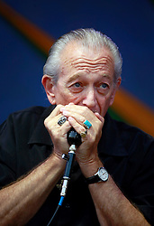 27 April 2013. New Orleans, Louisiana,  USA. .New Orleans Jazz and Heritage Festival. Charlie Musselwhite joins Ben Harper on the Gentilly stage..Photo; Charlie Varley.