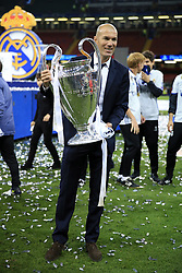 3rd June 2017 - UEFA Champions League Final - Juventus v Real Madrid - Real coach Zinedine Zidane holds the trophy - Photo: Simon Stacpoole / Offside.