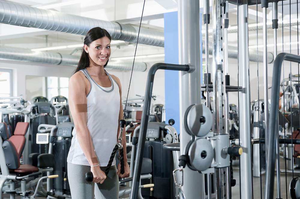 Attractive young woman portrait fitness studio