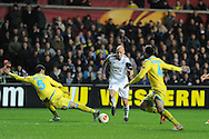 Jonjo Shelvey of Swansea city © makes a break. UEFA Europa league match , Swansea city v Napoli at the Liberty Stadium in Swansea, South Wales on Thursday 20th Feb 2014. pic by Andrew Orchard, Andrew Orchard sports photography.