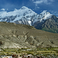 NEPAL, Himalaya. 23,166' Nilgiri Peak above barley fields in Thak Khola (Kali Gandaki) valley. (Annapurna massif).