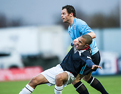 Falkirk's Phil Roberts with Dundee's Matthew Lockwood.<br /> Falkirk 2 v 0 Dundee, Scottish Championship game at The Falkirk Stadium.<br /> © Michael Schofield.