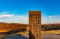 Khachkar  tombstone memorial with landscape panorama near Kornidzor in the caucasus mountain  landmark of Artsakh Nagorno-Karabakh Armenia eastern Europe