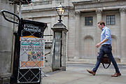 As heatwave temperatures climb to record levels - the hottest day of the year so far, the Evening Standard headline on page 1 of the London Evening Standard  mentions the UK's new Prime Minister Boris Johnson's first Cabinet Meeting and his threat on a No-Deal Brexit, opposite the Bank of England on Threadneedle Street in the City of London (the capital's financial district aka the Square Mile), on 25th July 2019, in London, England.