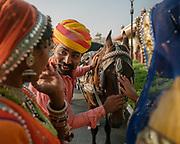Visiting Jaipur. Jai Mahal Palace gardens with models in traditional dress.