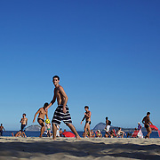 Locals practice foot  volley, a hybrid game combining beach volley ball and football at Ipanema beach, Rio de Janeiro,  Brazil. 4th July 2010. Photo Tim Clayton.