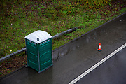 A green mobile toilet for truck drivers as freight Lorries line up in queues contained in operation Stack on the M20 motorway at Ashford, Kent, United Kingdom on the 23rd of December 2020. Truck drivers have been waiting in operation stack on the M20 motorway for over 48 hours now, France closed it's boarders with the UK after a new faster spreading strain of the COVID-19 virus broke out in Kent. (photo by Andrew Aitchison / In pictures via Getty Images)