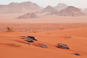 Red sand dunes and sandstone cliffs in Wadi Rum, Jordan.