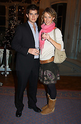MISS KATE MELHUISH and JACK FREUD at jewellers Tiffany's Christmas party held at The Savile Club, 69 Brook Street, London on 14th December 2004.<br />