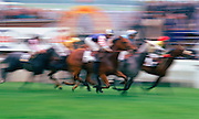 Soft focus horseracing action at Epsom Races in Surrey, United Kingdom on the famous Derby Day