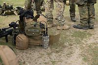 """03 APR 2012, LEHNIN/GERMANY:<br /> Schutzweste mit Funkgeraet, Kampfschwimmer der Bundeswehr trainieren """"an Land"""" infanteristische Kampf, hier Haeuserkampf- und Geiselbefreiungsszenarien auf einem Truppenuebungsplatz<br /> IMAGE: 20120403-01-158<br /> KEYWORDS: Marine, Bundesmarine, Soldat, Soldaten, Armee, Streitkraefte, Spezialkraefte, Spezialkräfte, Kommandoeinsatz, Übung, Uebung, Training, Spezialisierten Einsatzkraeften Marine, Waffentaucher"""