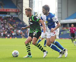 James Coppinger of Doncaster Rovers (L) and Charlie Mulgrew of Blackburn Rovers in action - Mandatory by-line: Jack Phillips/JMP - 12/08/2017 - FOOTBALL - Ewood Park - Blackburn, England - Blackburn Rovers v Doncaster Rovers - English Football League One